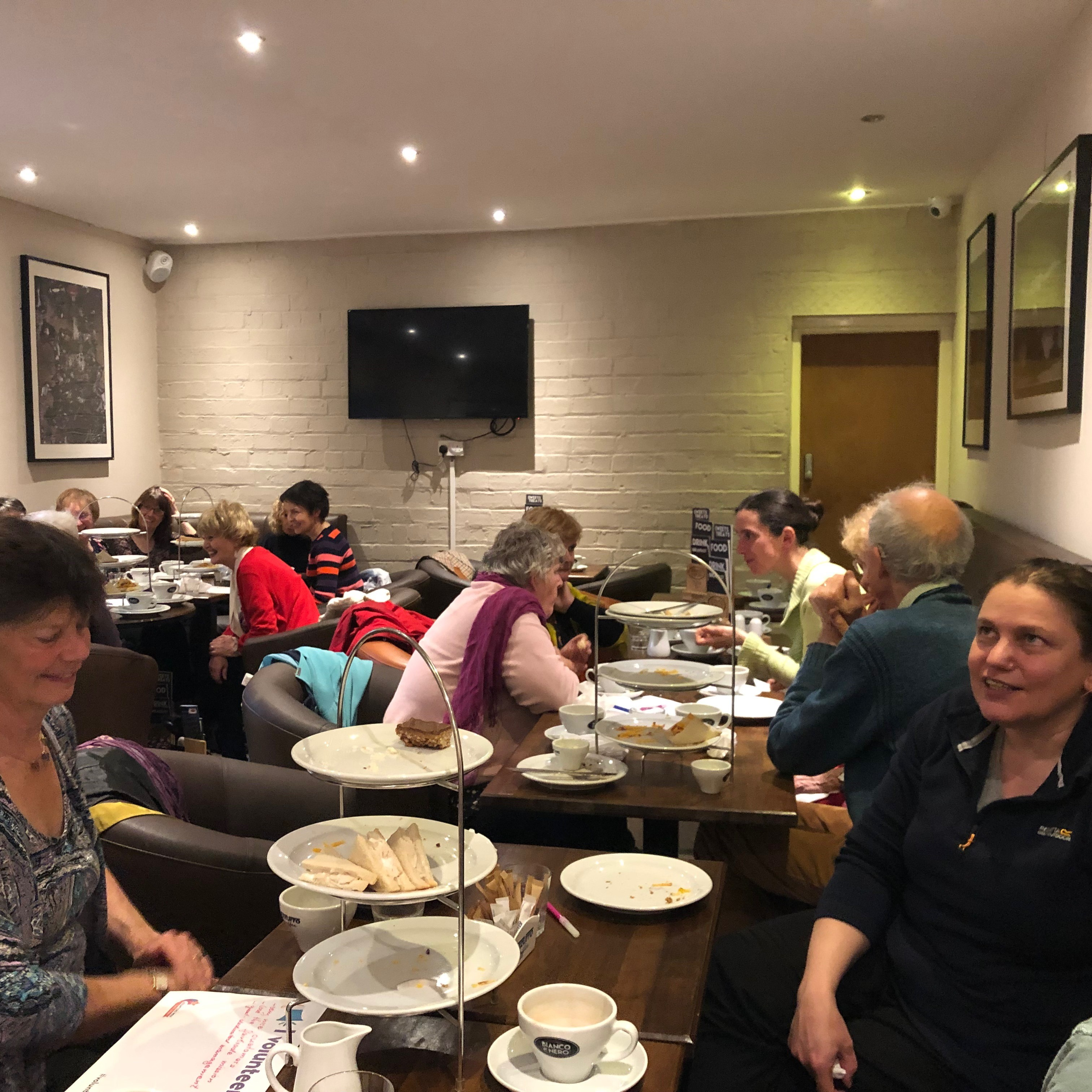 volunteers enjoy coffee and cake