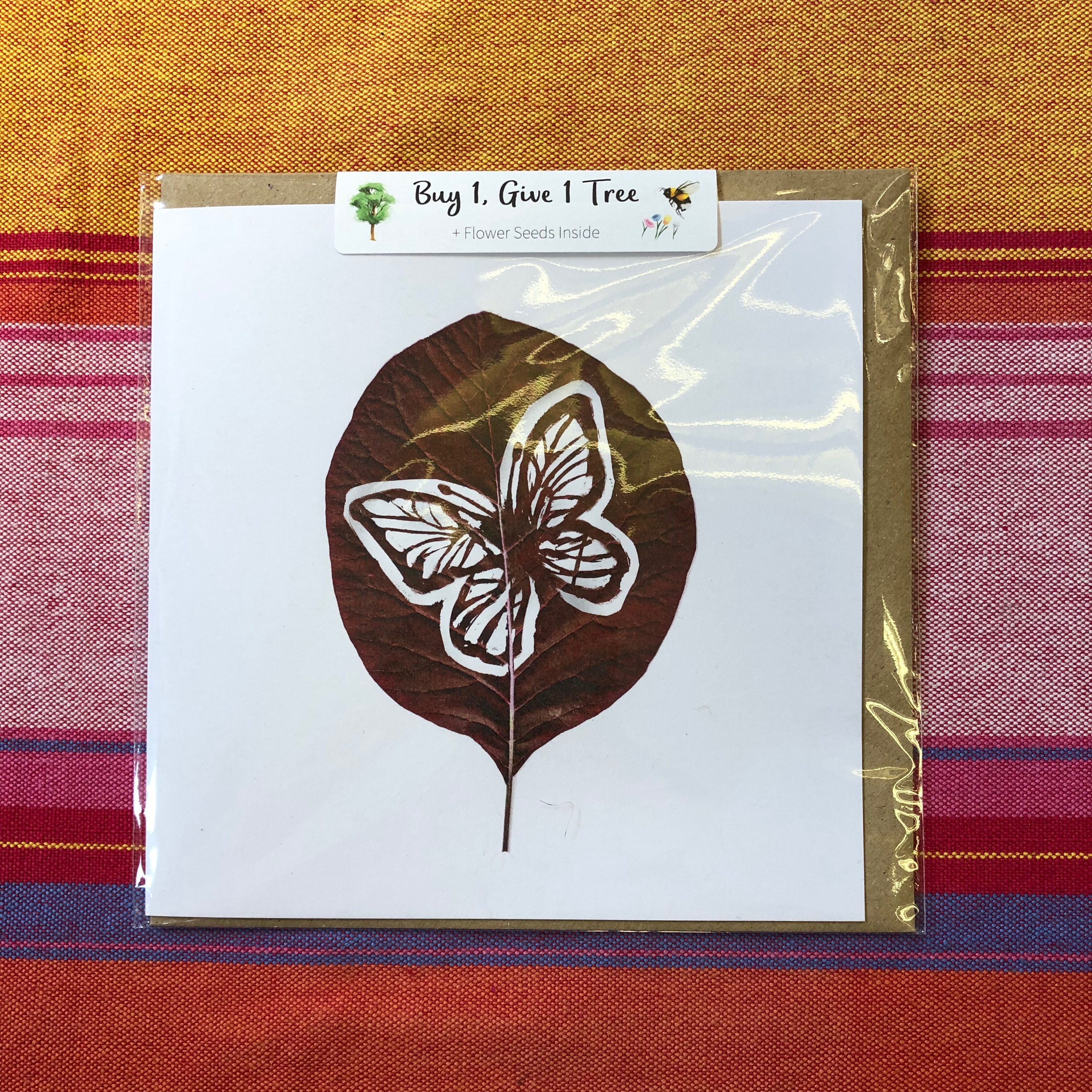 card with leaf and butterfly design